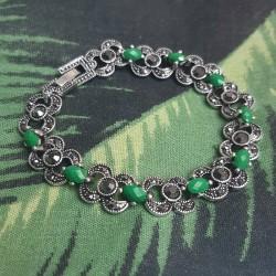 "Armband met groene ""oogjes"""